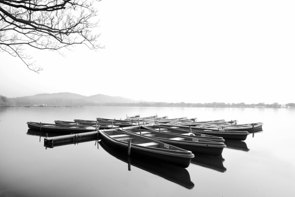 black and white fine art photograph of Hang Zhou West lake in a peaceful and calm water setting.